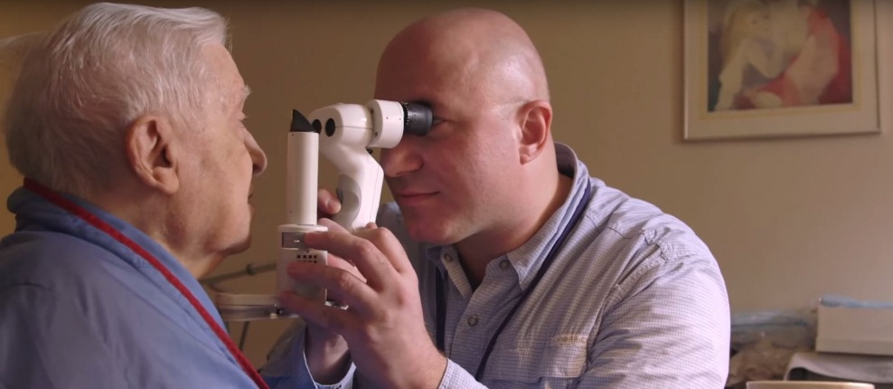 Elderly man reciving eye exam