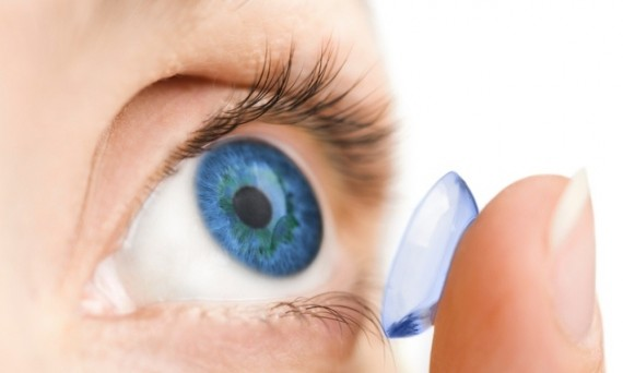Contact lens being insterted into eye