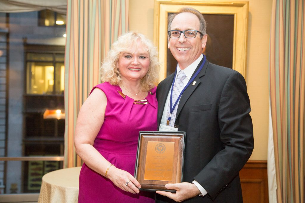 Dr. Denise Whittam, president of the College's alumni association, congratulates 2017 Alumnus of the Year Dr. Ken Sorkin.