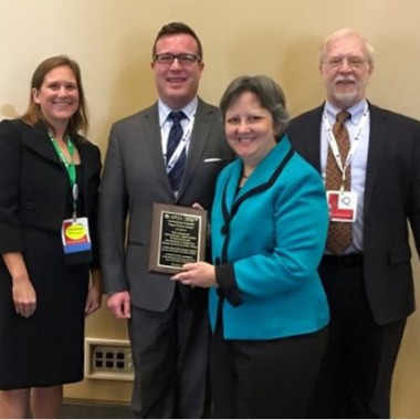 Dr. Adamczyk receiving the award for Distinguished Service to Optometry from the American Optometric Association