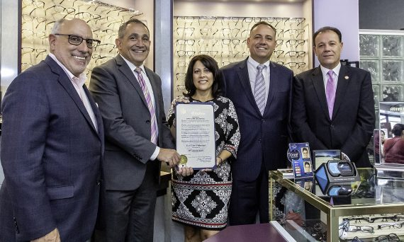 Assemblyman Michael Benedetto (left) and Councilman Mark Gjonaj (right) present a proclamation to Dr. Evan Kaplan, Dr. Annette Contento and Dr. A.J. Contento for their 25 years of service to Bronxites.