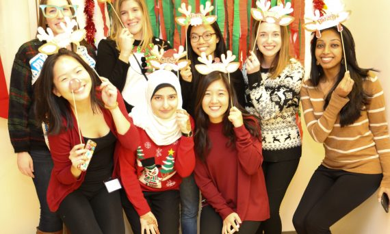 students at Optometry Holiday party with raindeer antlers