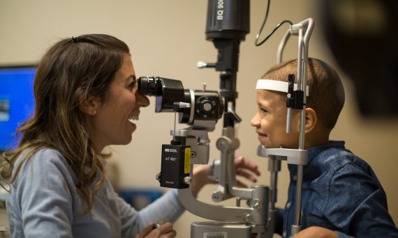 Myopia Control - Dr. Jenelle Mallios examines a young patient.