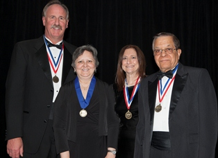 Dr. Adamczyk (second from left) at the National Academies of Practice induction ceremony