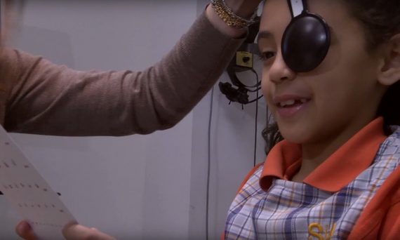 Child taking eye exam