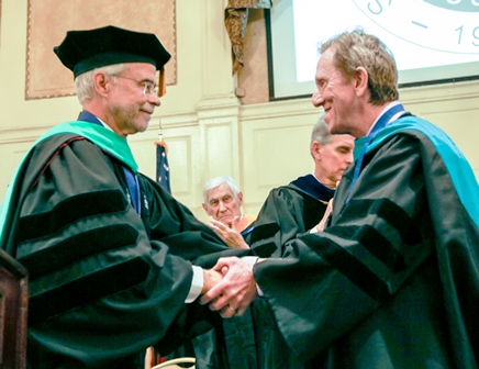 President Heath (left) congratulating Dr. Scott Richter after the presentation of the Presidential Medallion