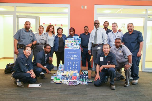 Members of the University Police Department, facilities, management services and housekeeping making their donations to the SUNY's Got Your Back campaign