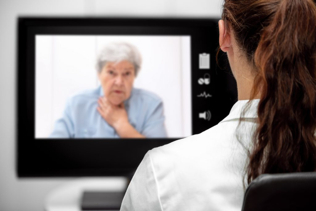 Elderly Woman with dyspnea, Doctor looking at the desk, telemedicine and telehealth with live chat