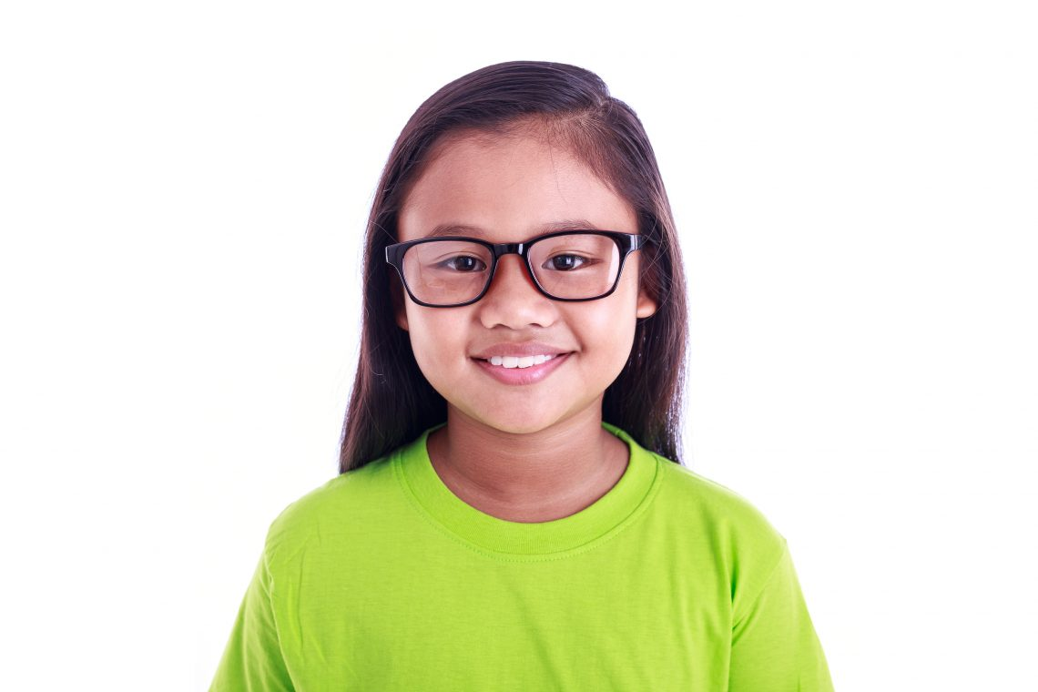 portrait of young asian girl wear glasses isolated on white suny