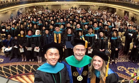 Dr. David Heath and graduates