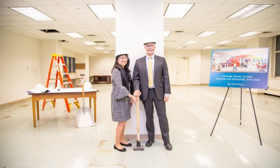 SUNY Optometry vice president for clinical administration Liduvina Martinez-Gonzalez and president David A. Heath lead groundbreaking ceremony for the new Center for Pediatric Eye Care, August 18, 2019.
