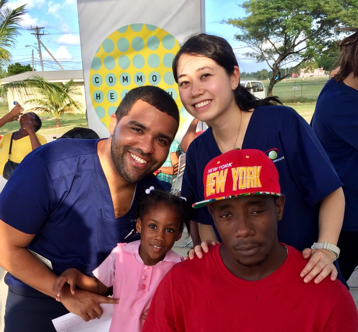 Dr. Jennifer Hue (standing, right) and Christian Alberto with patients in Hanover, Jamaica