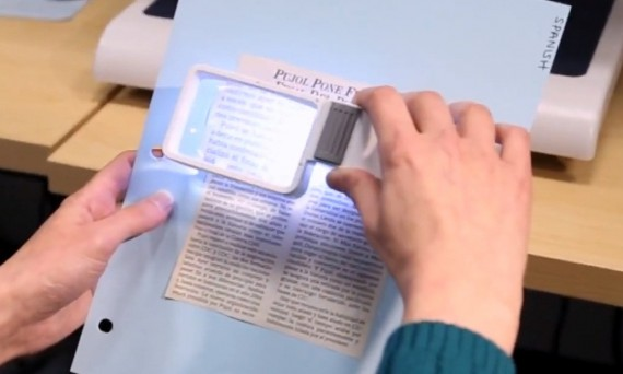 Looking at text through magnify glass
